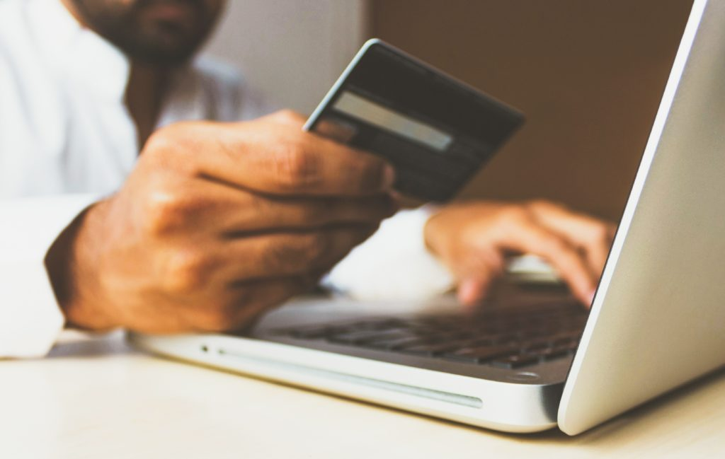 person paying online with card